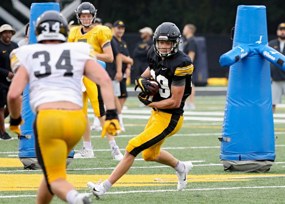 Iowa Hawkeyes wide receiver Jackson Ritter (29) pulls in a pass as linebacker Kristian Welch (34) closes in durning Fall Camp Practice No. 17 at the Hansen Football Performance Center in Iowa City on Wednesday, Aug 21, 2019. (Stephen Mally/hawkeyesports.com)