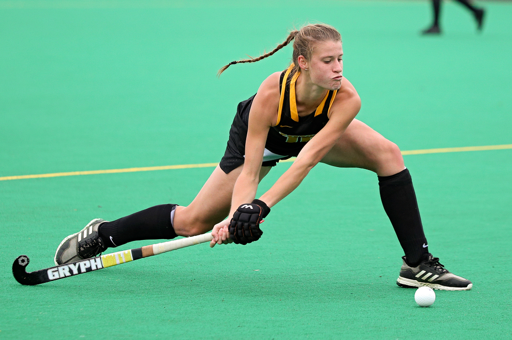 Iowa's Esme Gibson (15) lines up a shot during the fourth quarter of their game at Grant Field in Iowa City on Saturday, Oct 26, 2019. (Stephen Mally/hawkeyesports.com)