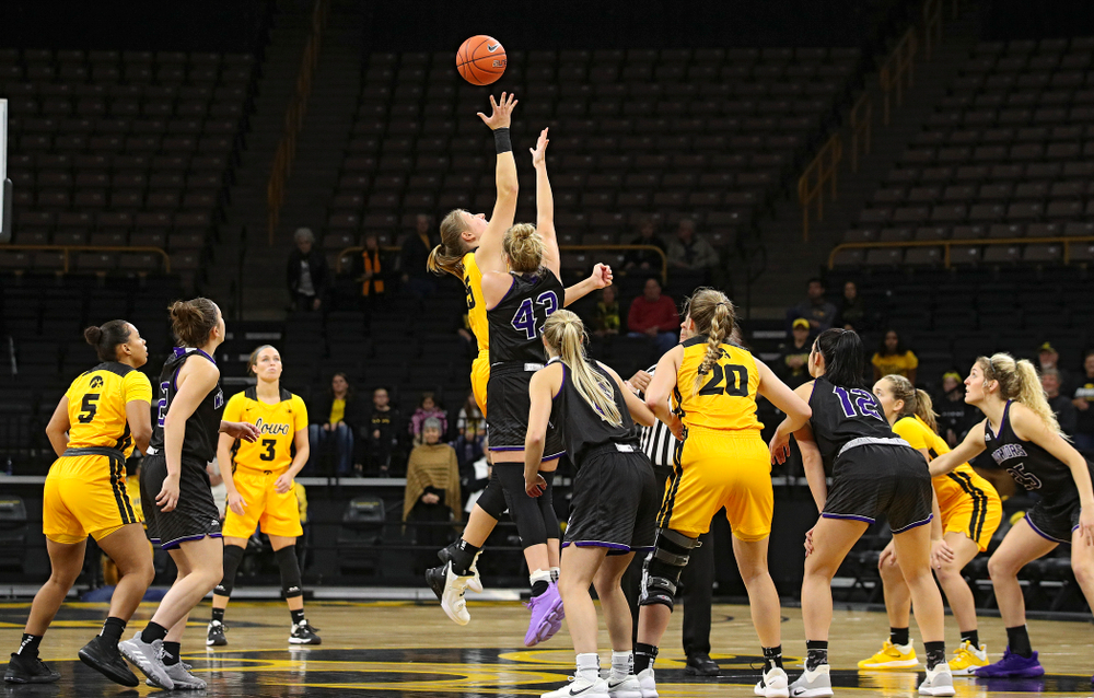 Iowa forward/center Monika Czinano (25) wins the opening tip during the first quarter of their game against Winona State at Carver-Hawkeye Arena in Iowa City on Sunday, Nov 3, 2019. (Stephen Mally/hawkeyesports.com)