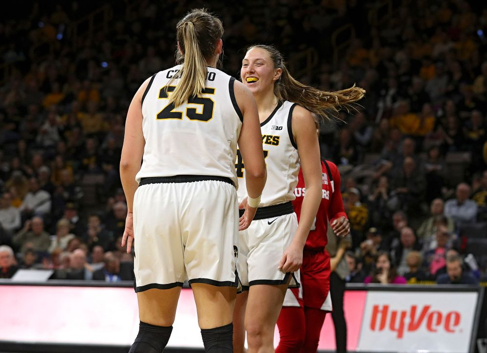 Iowa Hawkeyes forward Monika Czinano (25) celebrates with forward Amanda Ollinger (43) during the fourth quarter of the game at Carver-Hawkeye Arena in Iowa City on Thursday, February 6, 2020. (Stephen Mally/hawkeyesports.com)