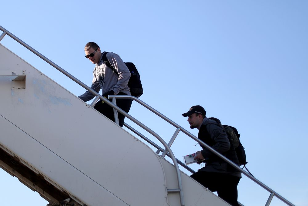 Iowa Hawkeyes quarterback Nate Stanley (4) and quarterback Peyton Mansell (2) board the team plane at the Eastern Iowa Airport Saturday, December 21, 2019 on the way to San Diego, CA for the Holiday Bowl. (Brian Ray/hawkeyesports.com)