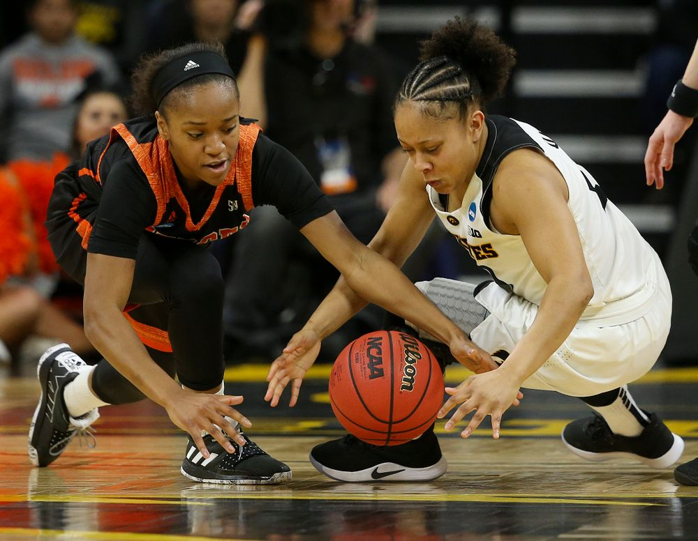 Iowa Hawkeyes guard Tania Davis (11) and Mercer Bears guard Keke Calloway (left) battle for a loose ball during the first round of the 2019 NCAA Women's Basketball Tournament at Carver Hawkeye Arena in Iowa City on Friday, Mar. 22, 2019. (Stephen Mally for hawkeyesports.com)
