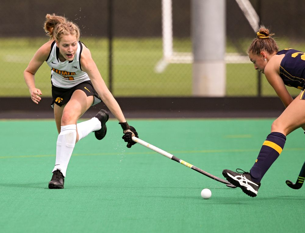 Iowa's Sofie Stribos (9) reaches for the ball during the first quarter of their game at Grant Field in Iowa City on Friday, Sep 13, 2019. (Stephen Mally/hawkeyesports.com)