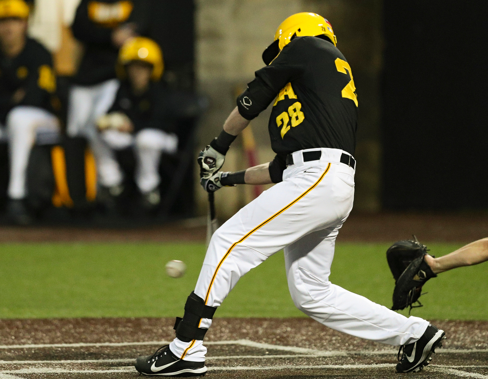 Iowa Hawkeyes left fielder Chris Whelan (28) hits an RBI single during the sixth inning of their game against Western Illinois at Duane Banks Field in Iowa City on Wednesday, May. 1, 2019. (Stephen Mally/hawkeyesports.com)