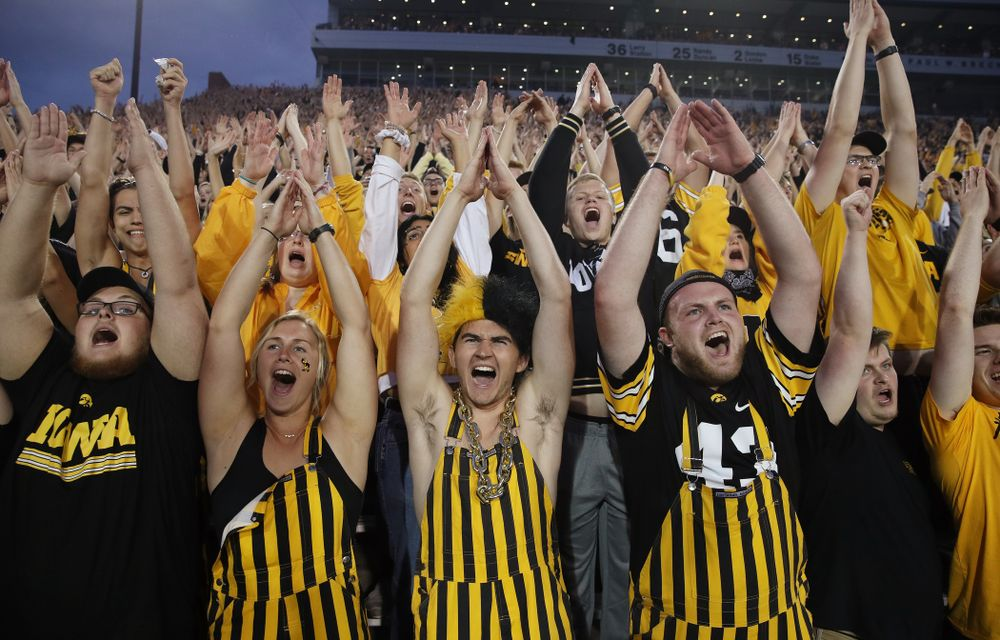 The student second cheers for the Iowa Hawkeyes against the Miami RedHawks Saturday, August 31, 2019 at Kinnick Stadium in Iowa City. (Brian Ray/hawkeyesports.com)