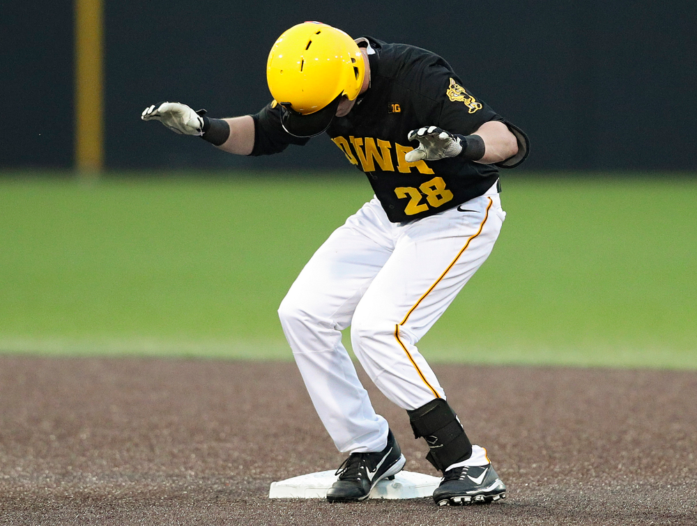 Iowa Hawkeyes left fielder Chris Whelan (28) dances on second base after hitting a double during the fourth inning of their game against Western Illinois at Duane Banks Field in Iowa City on Wednesday, May. 1, 2019. (Stephen Mally/hawkeyesports.com)