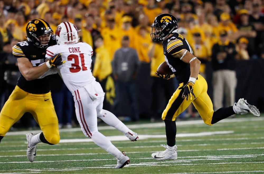 Iowa Hawkeyes wide receiver Kyle Groeneweg (14) returns a punt during a game against Wisconsin at Kinnick Stadium on September 22, 2018. (Tork Mason/hawkeyesports.com)