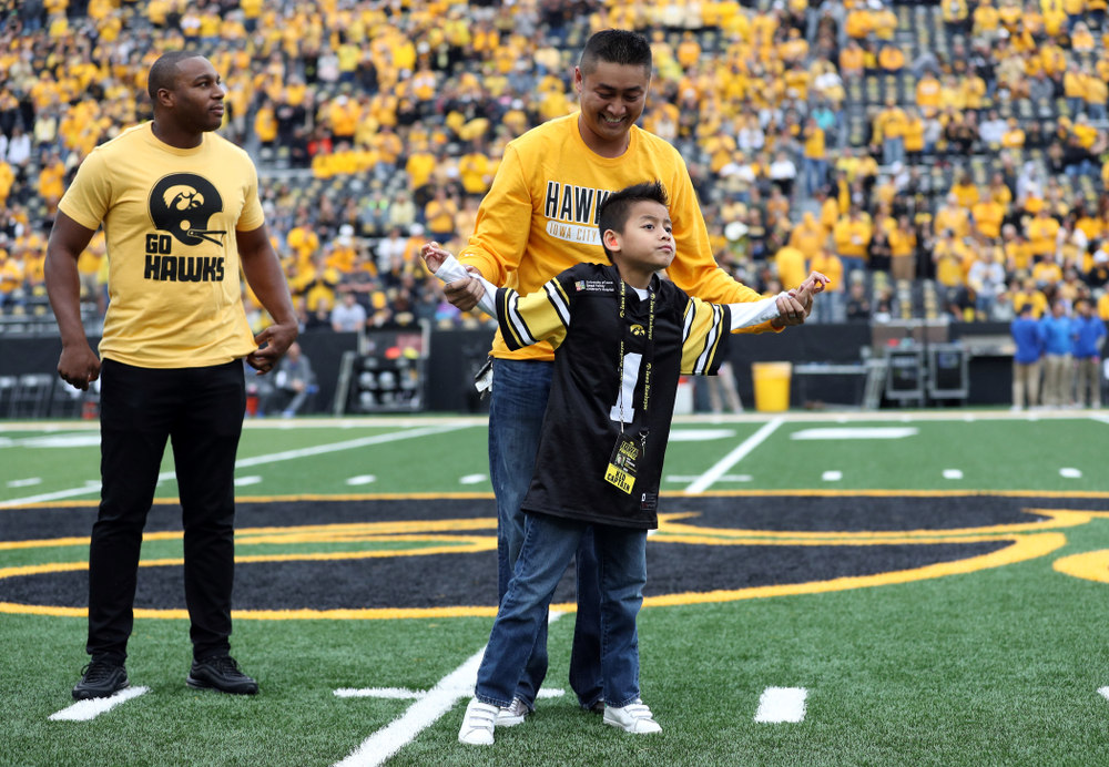 Stead Family ChildrenÕs Hospital Kid Captain Enzo Thongsoum and honorary captain Miguel Merrick before the Iowa Hawkeyes game against Middle Tennessee State Saturday, September 28, 2019 at Kinnick Stadium. (Max Allen/hawkeyesports.com)