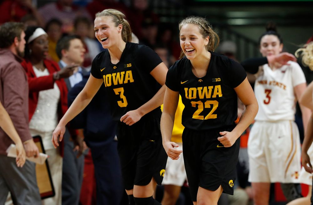 Iowa Hawkeyes guard Makenzie Meyer (3) and Hawkeyes guard Kathleen Doyle (22) before the hand Iowa Hawkeyes guard Makenzie Meyer