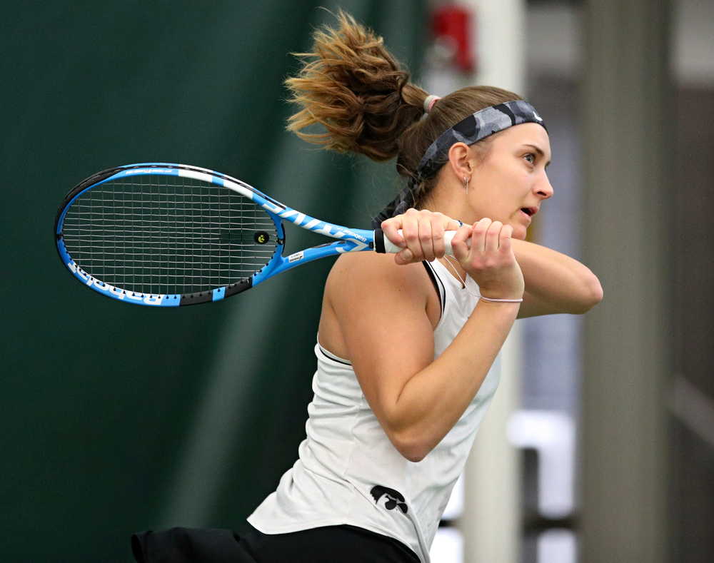 Iowa's Ashleigh Jacobs returns a shot during her singles match at the Hawkeye Tennis and Recreation Complex in Iowa City on Sunday, February 16, 2020. (Stephen Mally/hawkeyesports.com)