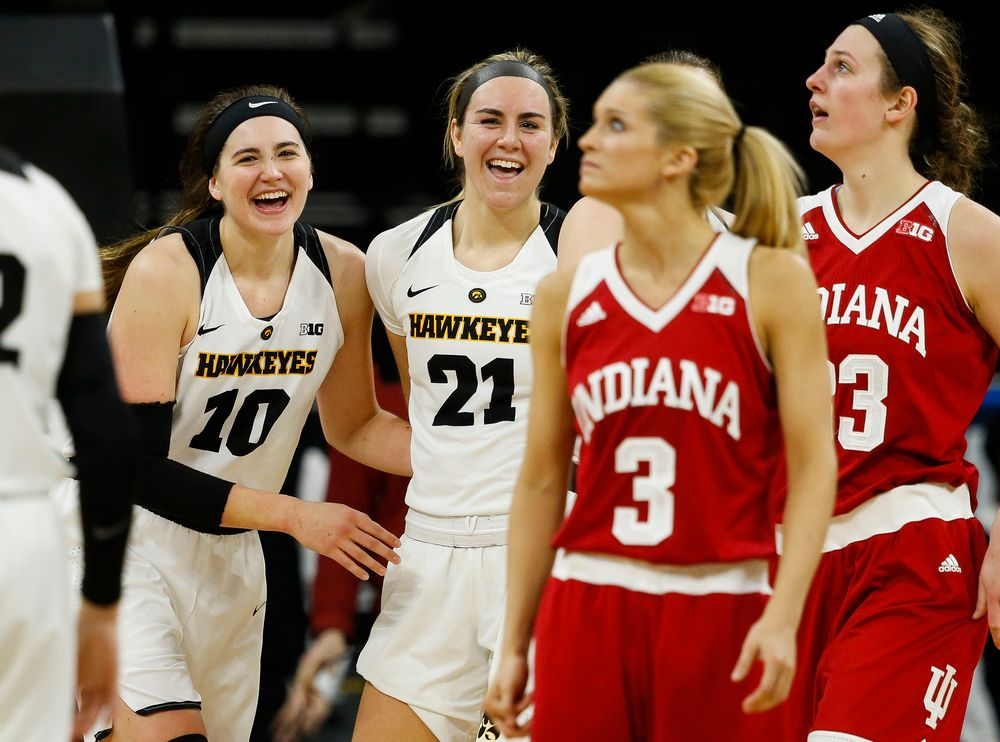 Iowa Hawkeyes forward Megan Gustafson (10), Iowa Hawkeyes forward Hannah Stewart (21)