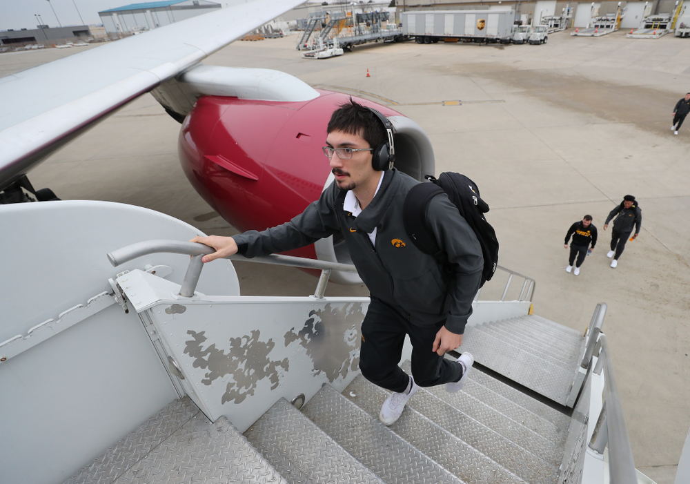 Iowa Hawkeyes place kicker Miguel Recinos (91) boards the team plane Wednesday, December 26, 2018 as they travel to Tampa, Florida for the Outback Bowl. (Brian Ray/hawkeyesports.com)