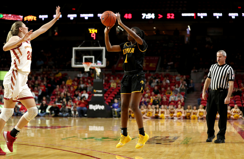 Iowa Hawkeyes guard Tomi Taiwo  (1) knocks down a three point basket against the Iowa State Cyclones Wednesday, December 11, 2019 at Hilton Coliseum in Ames, Iowa(Brian Ray/hawkeyesports.com)
