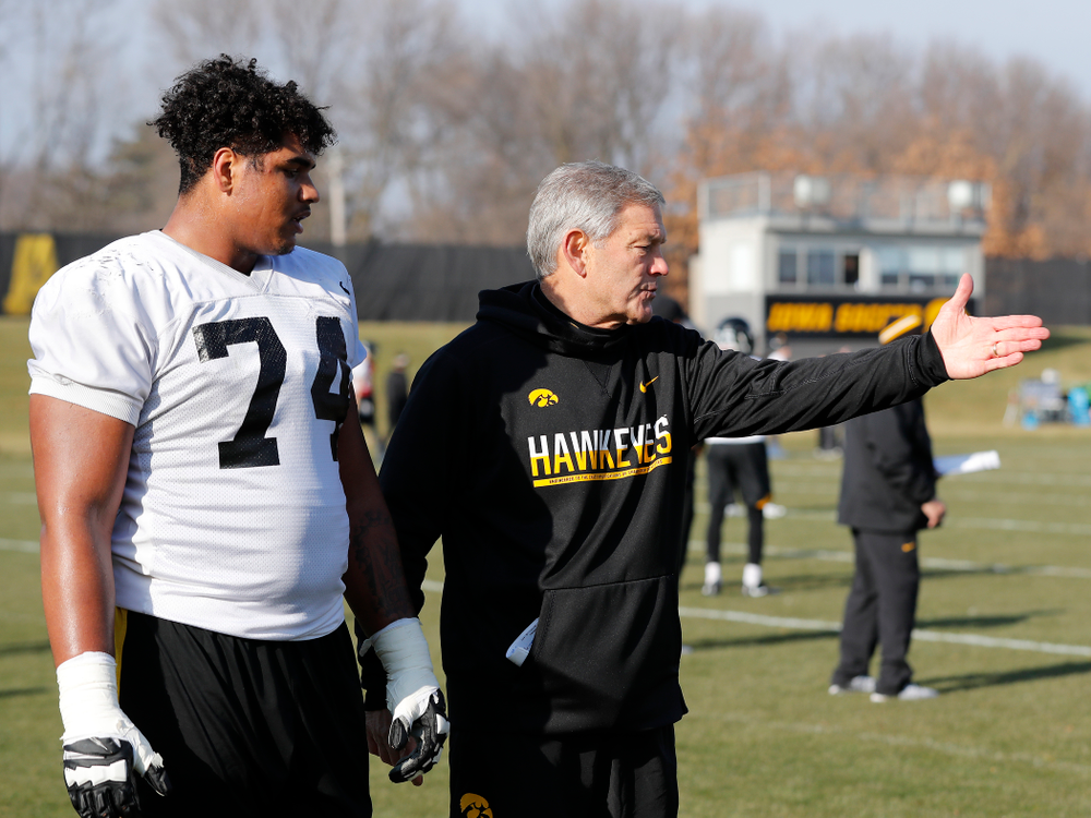 Iowa Hawkeyes head coach Kirk Ferentz and offensive lineman Tristan Wirfs (74)
