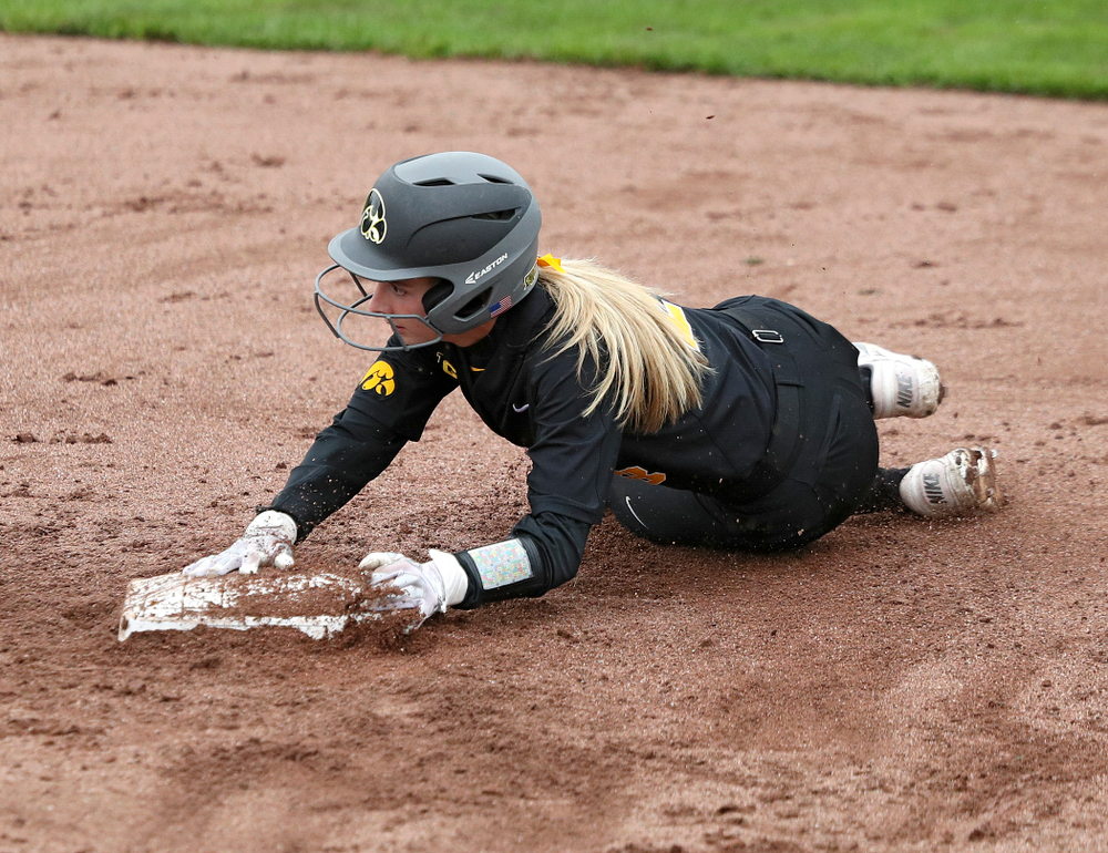 Iowa infielder Taylor Ryan (28) steals second base during the sixth inning of their game against Iowa Softball vs Indian Hills Community College at Pearl Field in Iowa City on Sunday, Oct 6, 2019. (Stephen Mally/hawkeyesports.com)