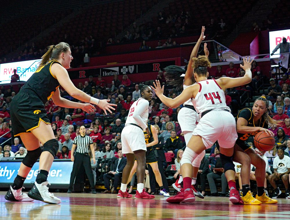 Iowa guard Alexis Sevillian (5) passes the ball to forward/center Monika Czinano (25) during the third quarter of their game at the Rutgers Athletic Center in Piscataway, N.J. on Sunday, March 1, 2020. (Stephen Mally/hawkeyesports.com)
