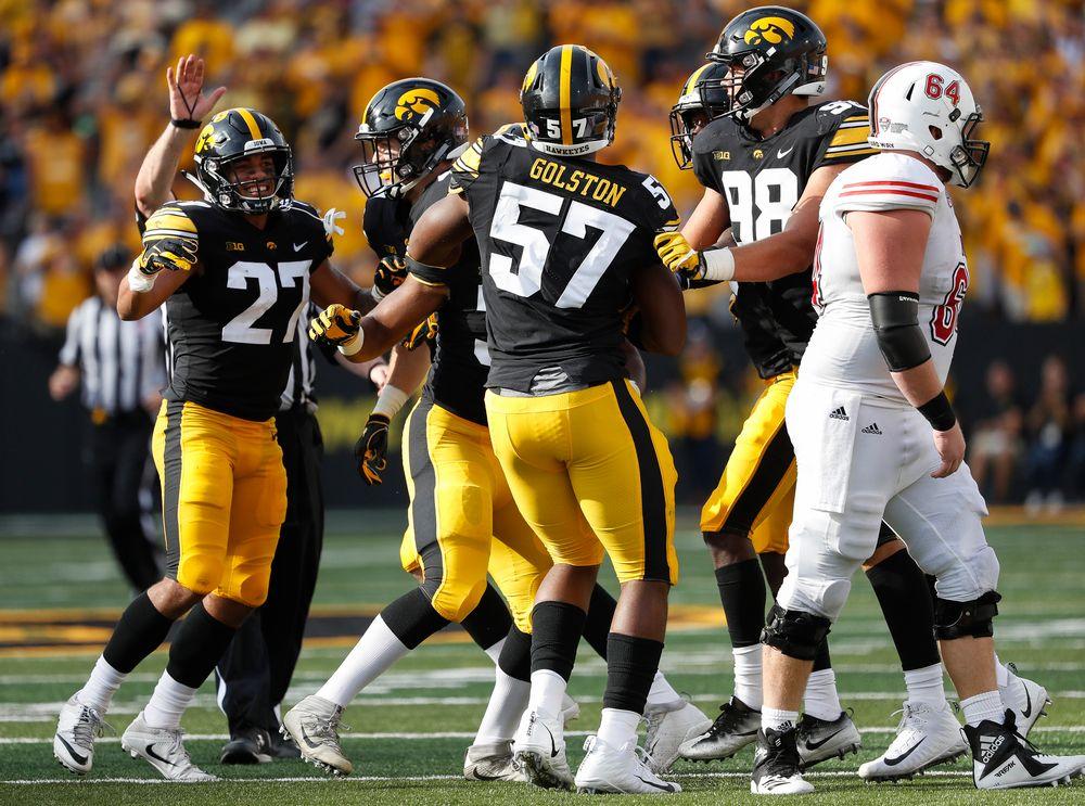 Iowa Hawkeyes defensive back Amani Hooker (27), Iowa Hawkeyes defensive end Chauncey Golston (57)