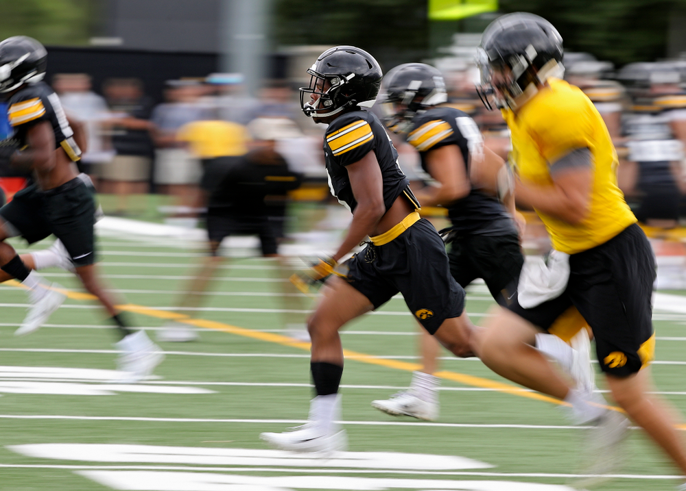Iowa Hawkeyes wide receiver Tyrone Tracy Jr. (3) runs with his teammates as he warms up during Fall Camp Practice No. 15 at the Hansen Football Performance Center in Iowa City on Monday, Aug 19, 2019. (Stephen Mally/hawkeyesports.com)