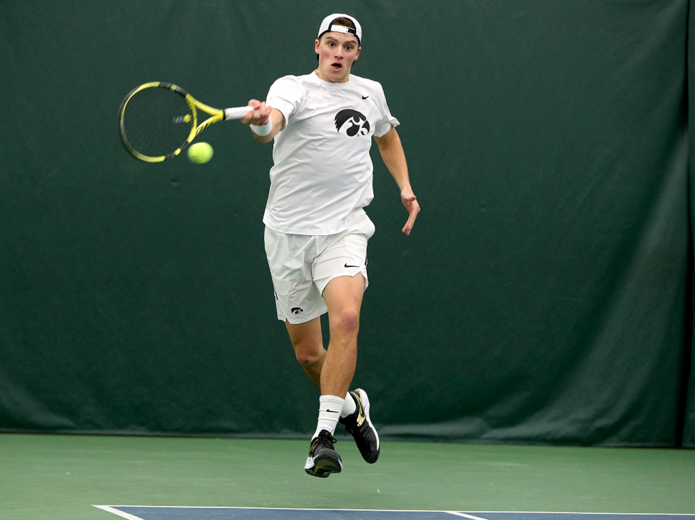 Iowa's Joe Tyler returns a shot during his singles match at the Hawkeye Tennis and Recreation Complex in Iowa City on Sunday, February 16, 2020. (Stephen Mally/hawkeyesports.com)