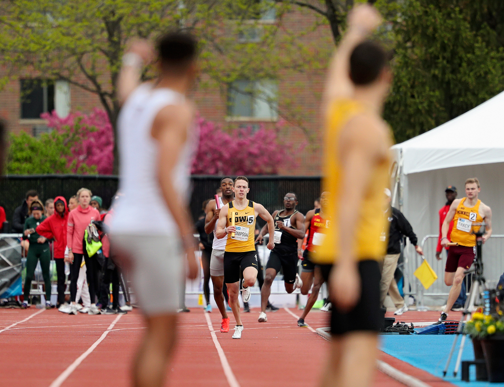 Iowa's Carter Lilly (right) waves at Chris Thompson as he approaches during the 1600 meter relay event on the third day of the Big Ten Outdoor Track and Field Championships at Francis X. Cretzmeyer Track in Iowa City on Sunday, May. 12, 2019. (Stephen Mally/hawkeyesports.com)