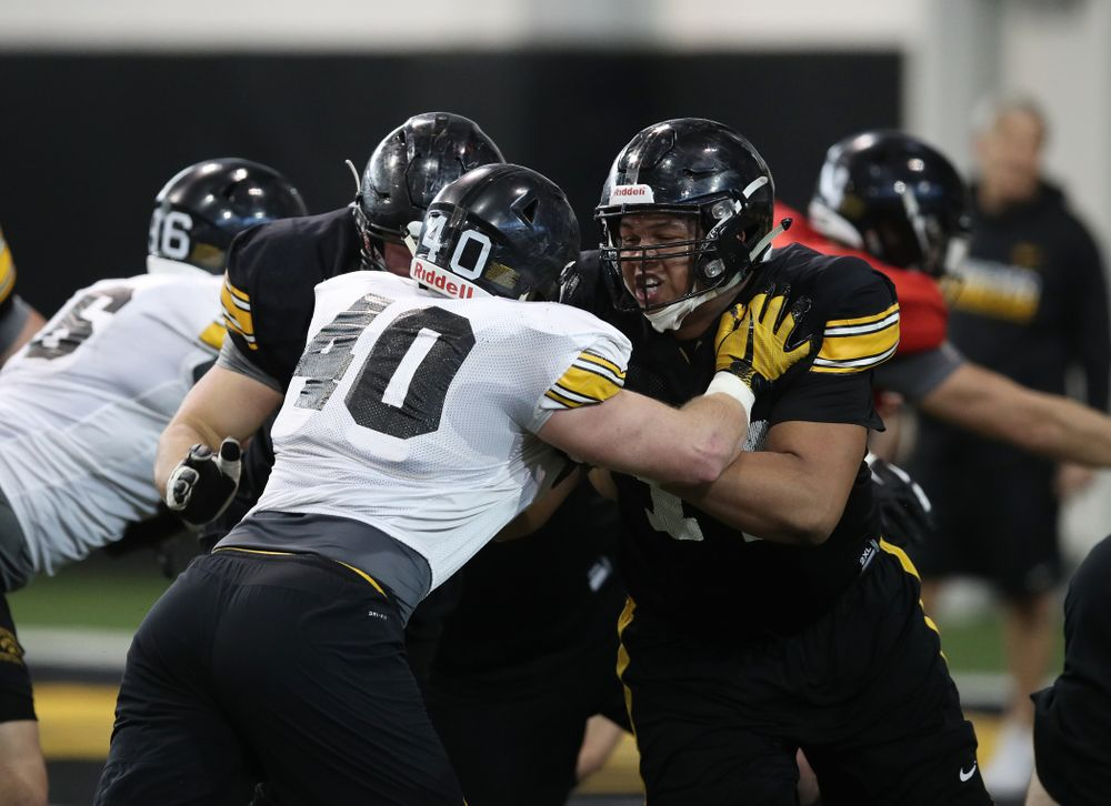 Iowa Hawkeyes offensive lineman Alaric Jackson (77) and defensive end Parker Hesse (40) during preparation for the 2019 Outback Bowl Monday, December 17, 2018 at the Hansen Football Performance Center. (Brian Ray/hawkeyesports.com)