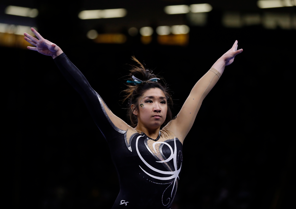 Iowa's Nicole Chow competes on the beam against the Nebraska Cornhuskers