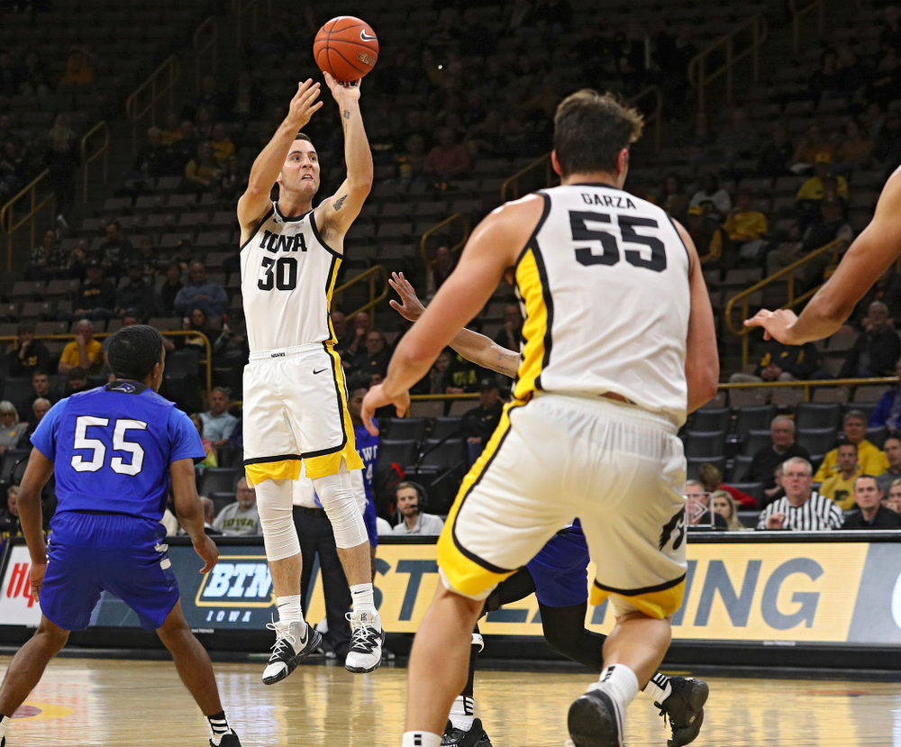 Iowa Hawkeyes guard Connor McCaffery (30) makes a 3-pointer during the second half of their exhibition game against Lindsey Wilson College at Carver-Hawkeye Arena in Iowa City on Monday, Nov 4, 2019. (Stephen Mally/hawkeyesports.com)