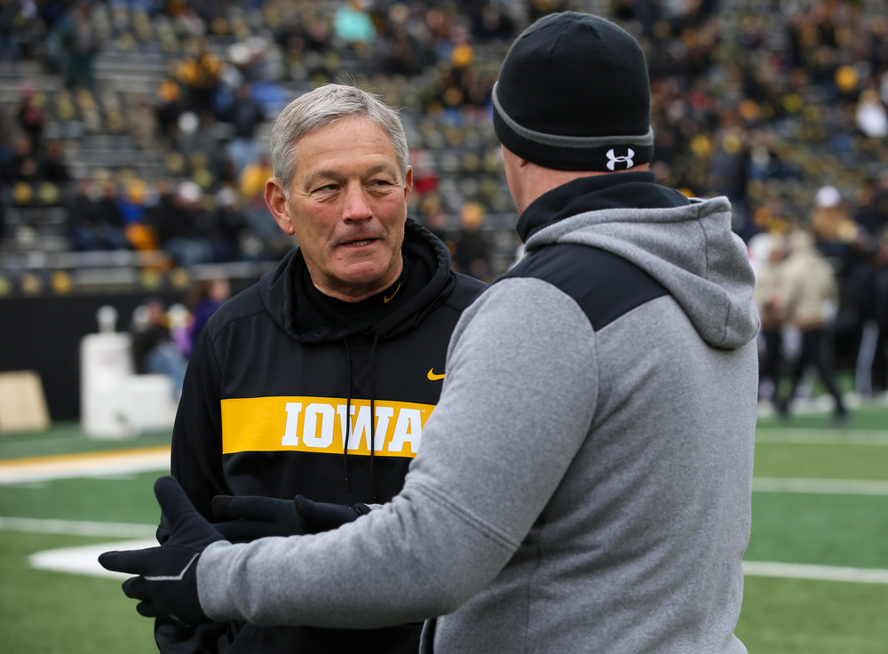 Iowa Hawkeyes head coach Kirk Ferentz talks with Northwestern Wildcats head coach Pat Fitzgerald before a game against Northwestern at Kinnick Stadium on November 10, 2018. (Tork Mason/hawkeyesports.com)