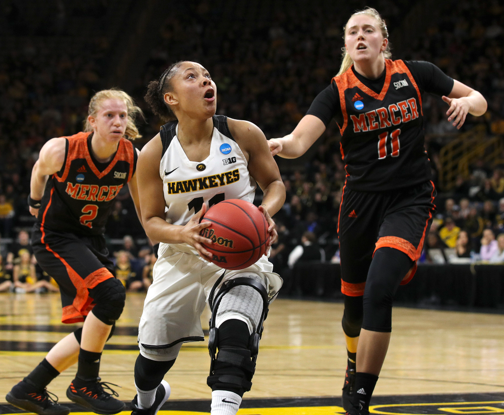 Iowa Hawkeyes guard Tania Davis (11) makes a basket during the first round of the 2019 NCAA Women's Basketball Tournament at Carver Hawkeye Arena in Iowa City on Friday, Mar. 22, 2019. (Stephen Mally for hawkeyesports.com)