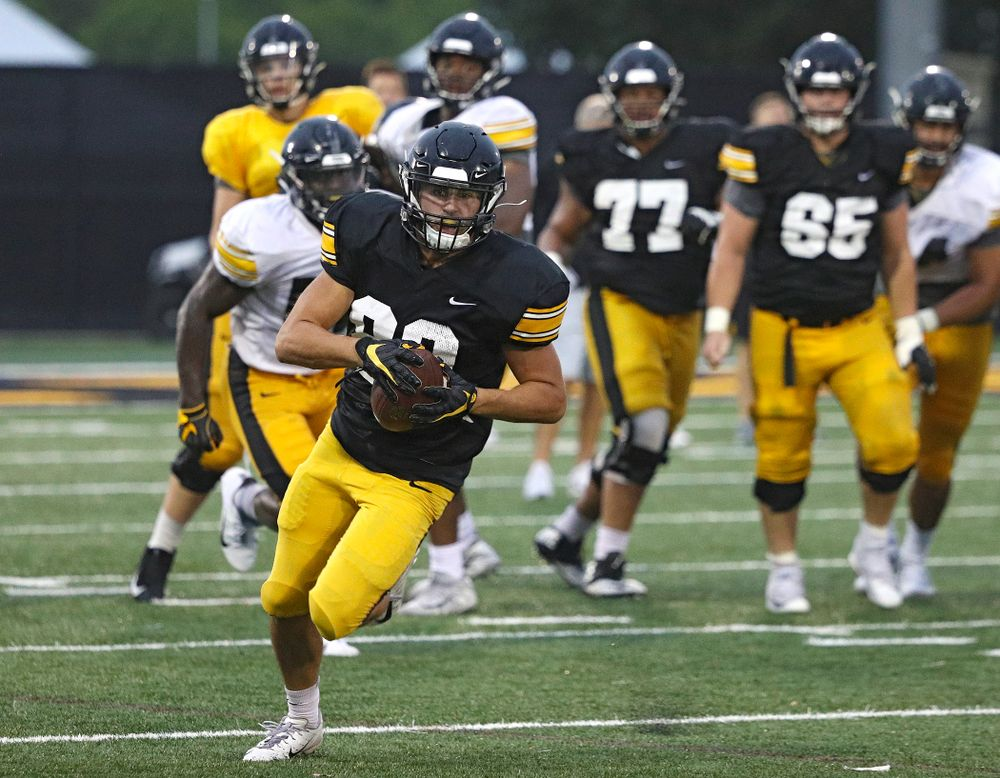 Iowa Hawkeyes wide receiver Nico Ragaini (89) runs after catching a pass durning Fall Camp Practice No. 17 at the Hansen Football Performance Center in Iowa City on Wednesday, Aug 21, 2019. (Stephen Mally/hawkeyesports.com)