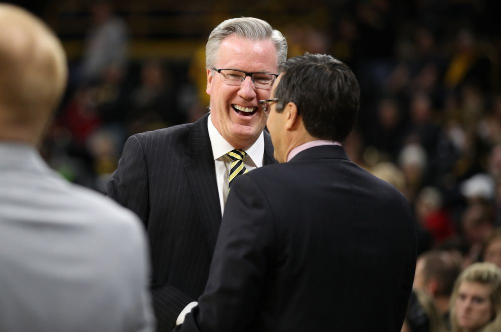 Iowa Hawkeyes head coach Fran McCaffery talks with Nebraska Cornhuskers head coach Tim Miles before their game Sunday, January 6, 2019 at Carver-Hawkeye Arena. (Brian Ray/hawkeyesports.com)