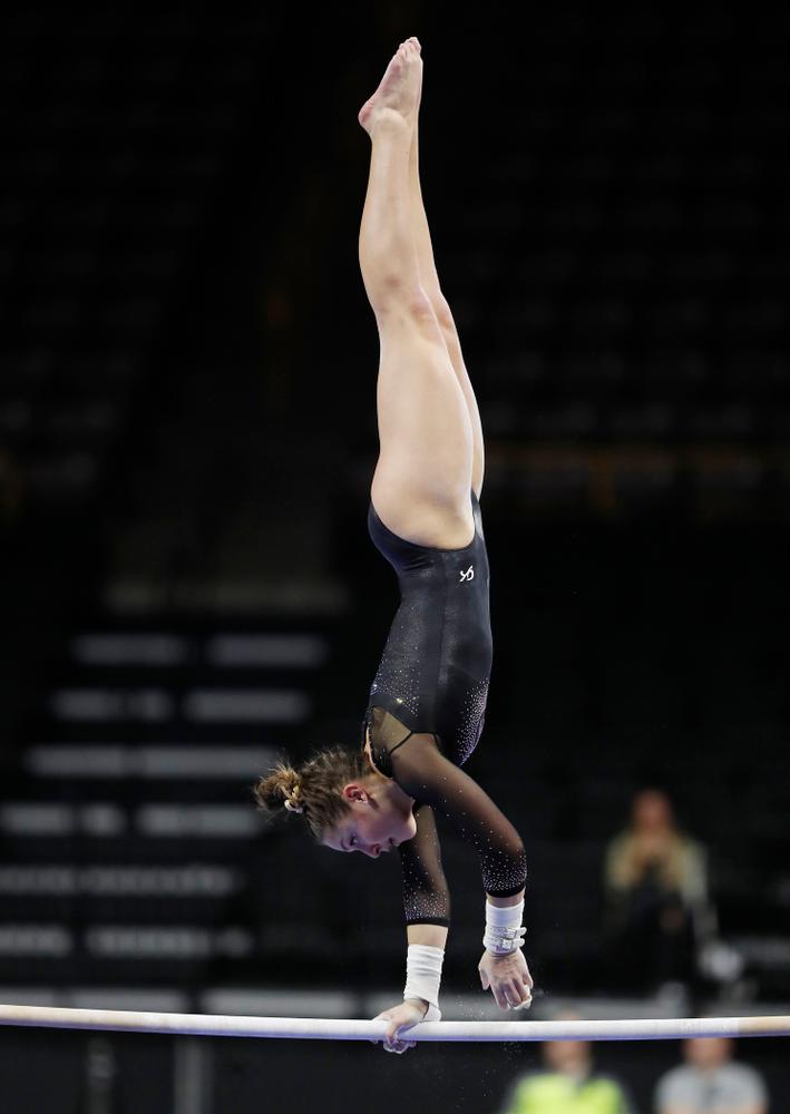 Melissa Zurawski competes on the bars