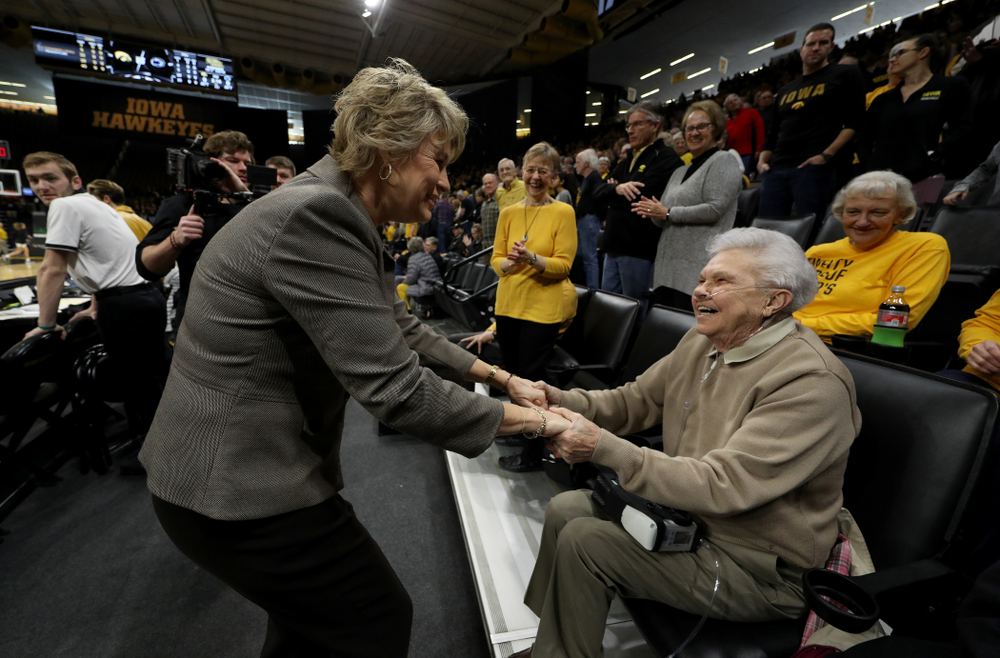 Iowa Hawkeyes head coach Lisa Bluder shakes hands with women's athletic director Dr. Christine Grant before their game against Penn State Saturday, February 22, 2020 at Carver-Hawkeye Arena. (Brian Ray/hawkeyesports.com)