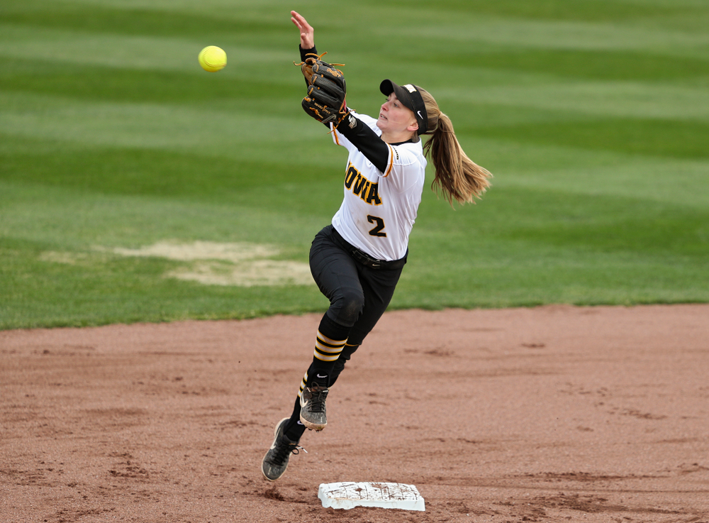 Iowa second baseman Aralee Bogar (2) pulls in a throw during the first inning of their game against Illinois at Pearl Field in Iowa City on Friday, Apr. 12, 2019. (Stephen Mally/hawkeyesports.com)
