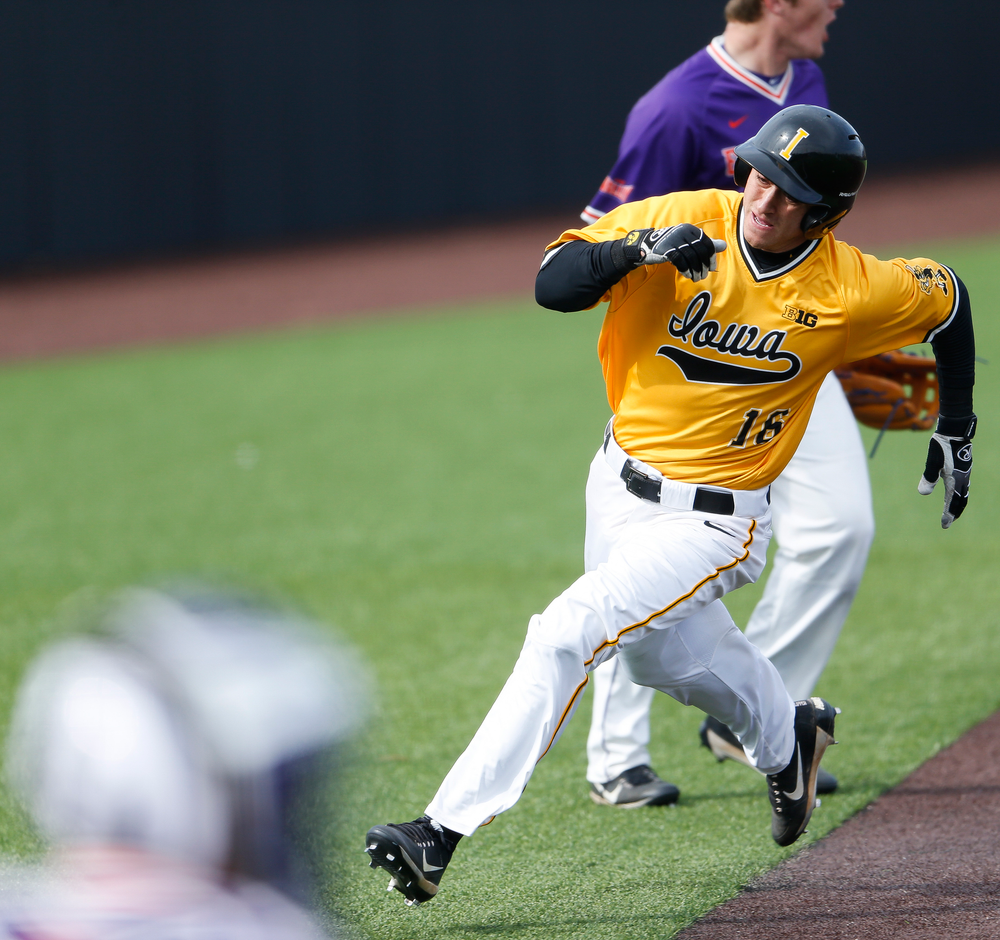 Iowa Hawkeyes outfielder Tanner Wetrich (16) comes home to score the game-tying run in the seventh inning during a game against Evansville at Duane Banks Field on March 18, 2018. (Tork Mason/hawkeyesports.com)