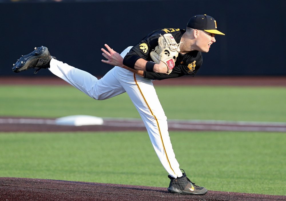 Iowa pitcher Adam Ketelsen (26) delivers to the plate during the fifth inning of their college baseball game at Duane Banks Field in Iowa City on Tuesday, March 10, 2020. (Stephen Mally/hawkeyesports.com)