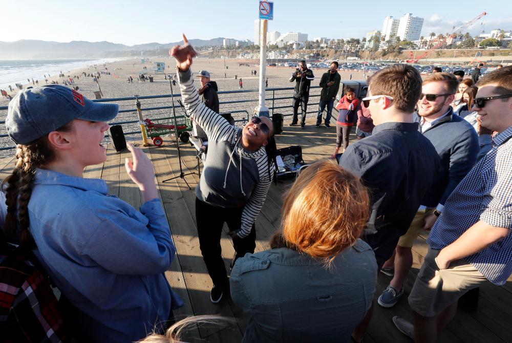 The Iowa Hawkeyes assistant coach Raina Harmon dances on the Santa Monica Pier Thursday, March 15, 2018 in Santa Monica. (Brian Ray/hawkeyesports.com)