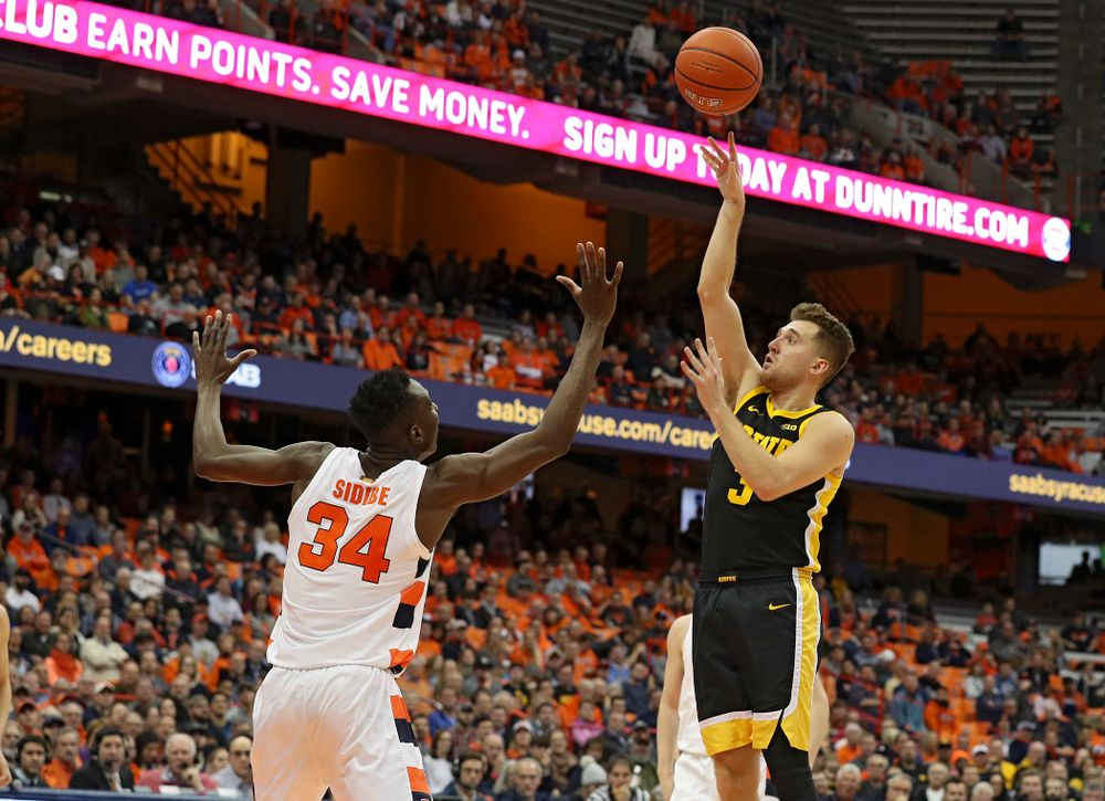 Iowa Hawkeyes guard Jordan Bohannon (3) makes a basket during the first half of their ACC/Big Ten Challenge game at the Carrier Dome in Syracuse, N.Y. on Tuesday, Dec 3, 2019. (Stephen Mally/hawkeyesports.com)