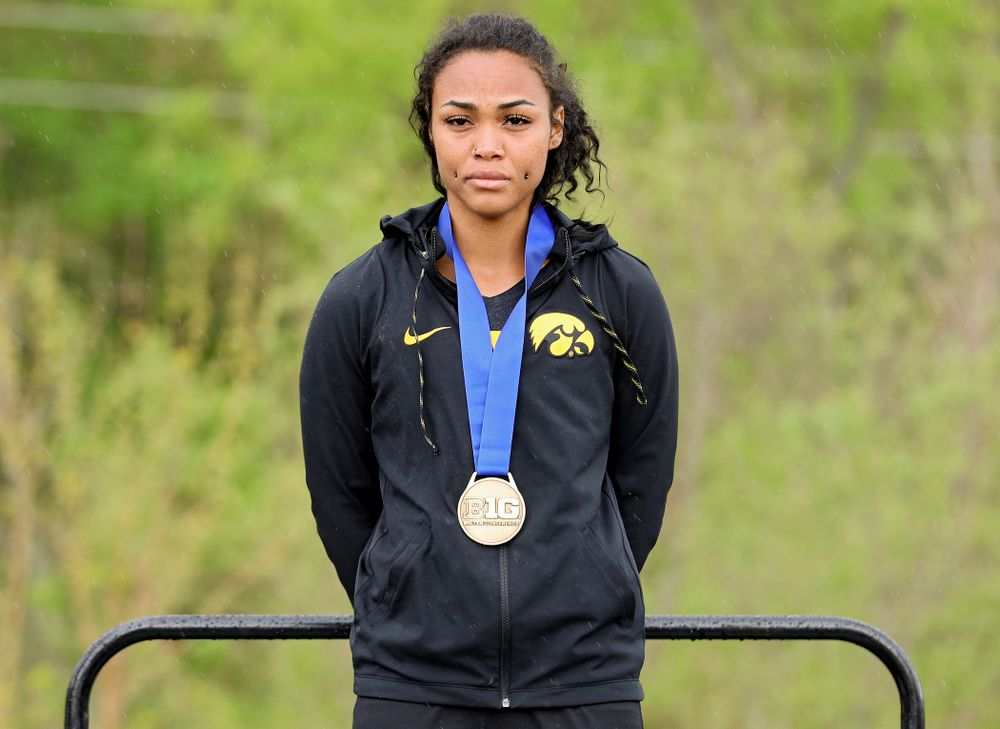 Iowa's Tria Simmons on the award stand after placing third in the heptathlon event on the second day of the Big Ten Outdoor Track and Field Championships at Francis X. Cretzmeyer Track in Iowa City on Saturday, May. 11, 2019. (Stephen Mally/hawkeyesports.com)
