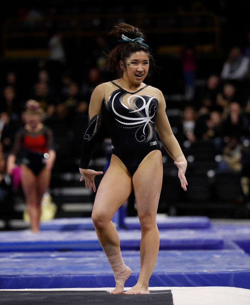 Iowa's Nicole Chow competes on the floor against the Nebraska Cornhuskers
