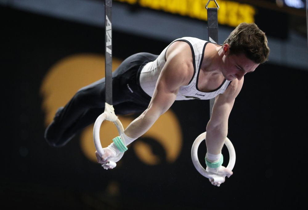 Iowa's Jake Brodarzon competes on the rings against UIC and Minnesota Saturday, February 2, 2019 at Carver-Hawkeye Arena. (Brian Ray/hawkeyesports.com)