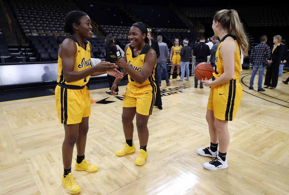 Iowa Hawkeyes guard Tomi Taiwo  (1), guard Zion Sanders (21), and guard Kate Martin (20) during the teamÕs annual media day Thursday, October 24, 2019 at Carver-Hawkeye Arena. (Brian Ray/hawkeyesports.com)