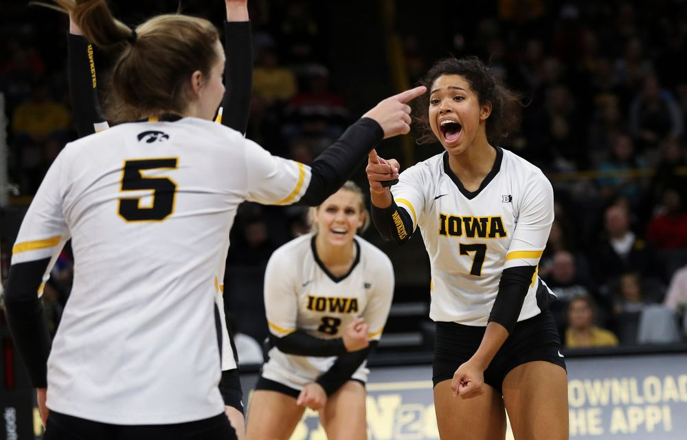 Iowa Hawkeyes setter Brie Orr (7) celebrates after winning a point during a match against Maryland at Carver-Hawkeye Arena on November 23, 2018. (Tork Mason/hawkeyesports.com)