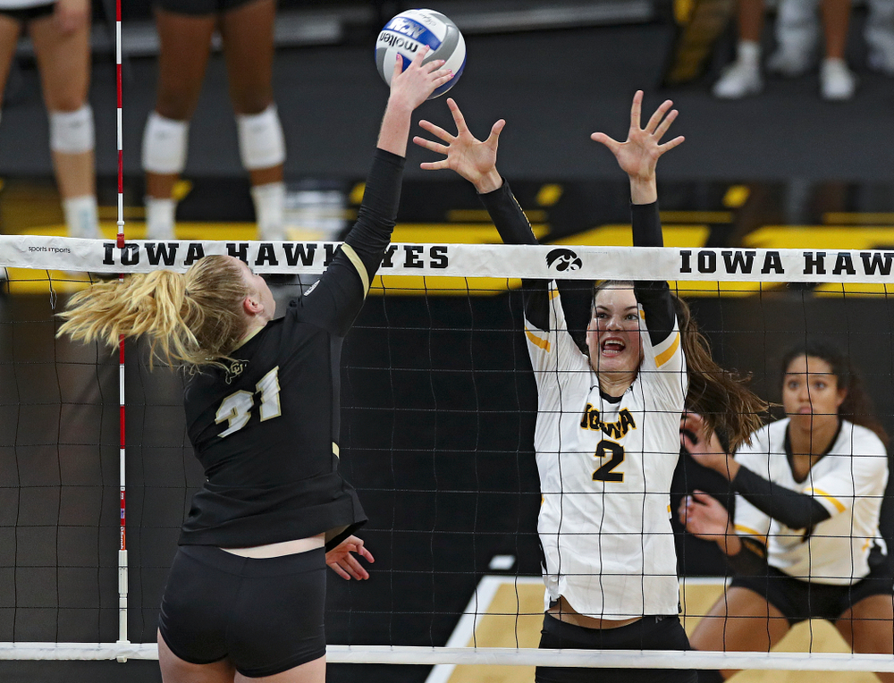Iowa's Courtney Buzzerio (2) tries for a block during the first set of their Big Ten/Pac-12 Challenge match against Colorado at Carver-Hawkeye Arena in Iowa City on Friday, Sep 6, 2019. (Stephen Mally/hawkeyesports.com)