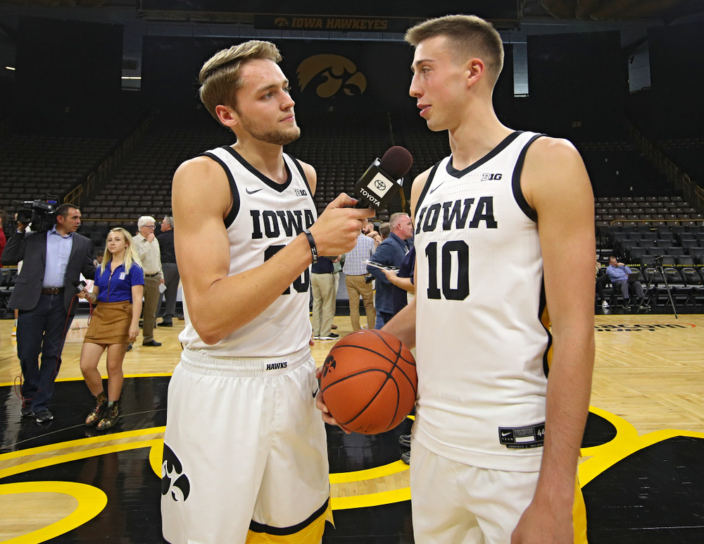 Iowa Hawkeyes forward Riley Till (20) asks guard Joe Wieskamp (10) a question during Iowa Men's Basketball Media Day at Carver-Hawkeye Arena in Iowa City on Wednesday, Oct 9, 2019. (Stephen Mally/hawkeyesports.com)