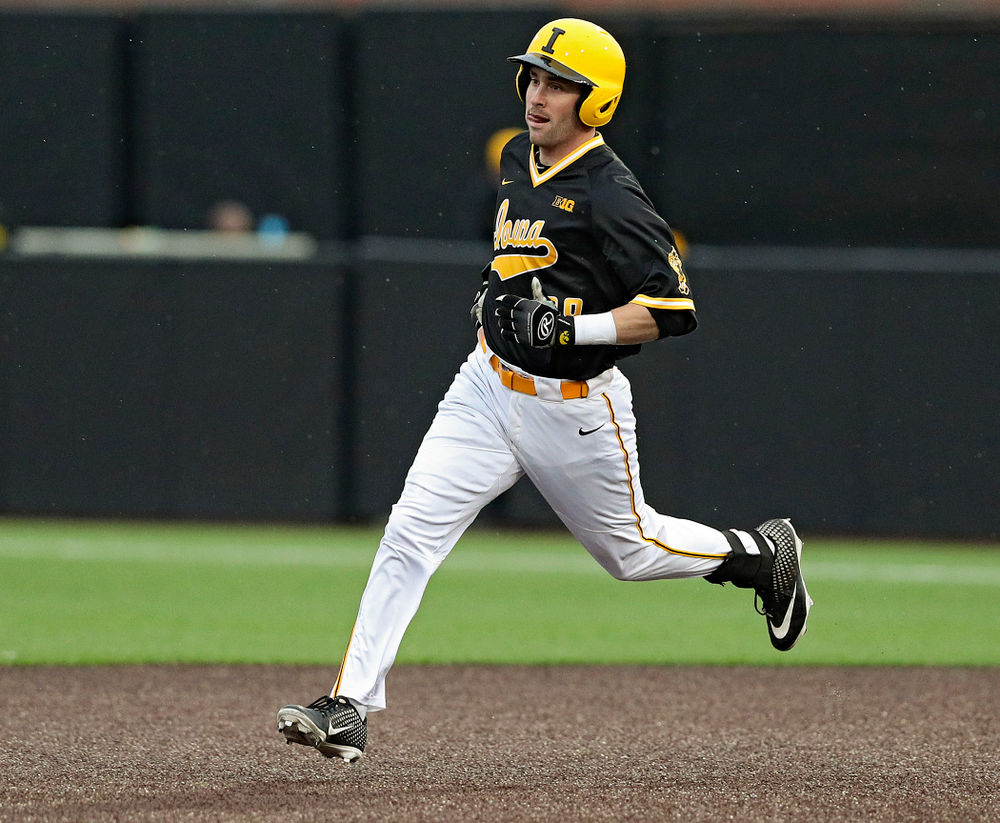 Iowa Hawkeyes left fielder Chris Whelan (28) runs to second base after hitting a double during the seventh inning of their game against Illinois State at Duane Banks Field in Iowa City on Wednesday, Apr. 3, 2019. (Stephen Mally/hawkeyesports.com)