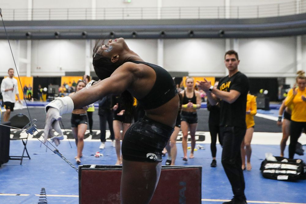 Jerquavia Henderson dismounts from the uneven bars during the Iowa women's gymnastics Black and Gold Intraquad Meet on Saturday, December 7, 2019 at the UI Field House. (Lily Smith/hawkeyesports.com)
