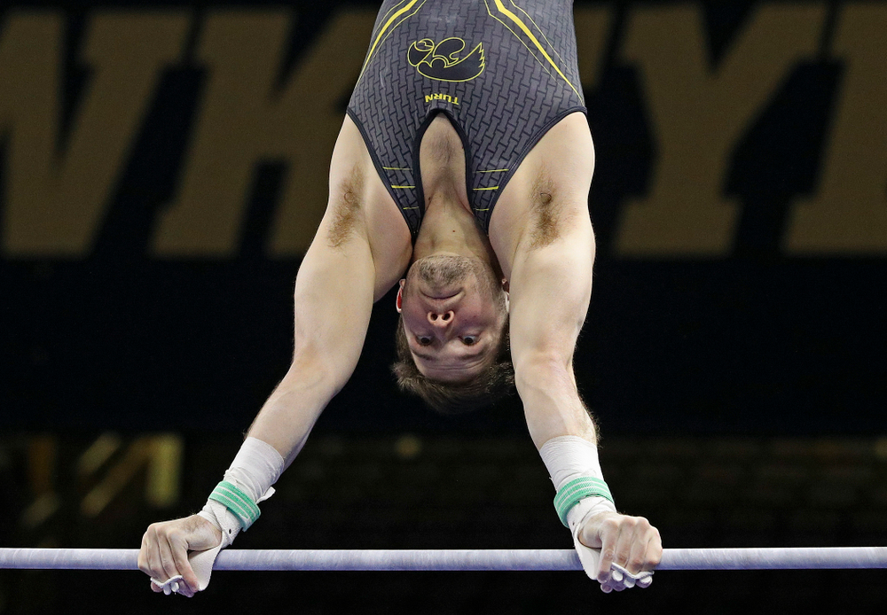 Iowa's Rogelio Vazquez competes in the horizontal bar during the first day of the Big Ten Men's Gymnastics Championships at Carver-Hawkeye Arena in Iowa City on Friday, Apr. 5, 2019. (Stephen Mally/hawkeyesports.com)