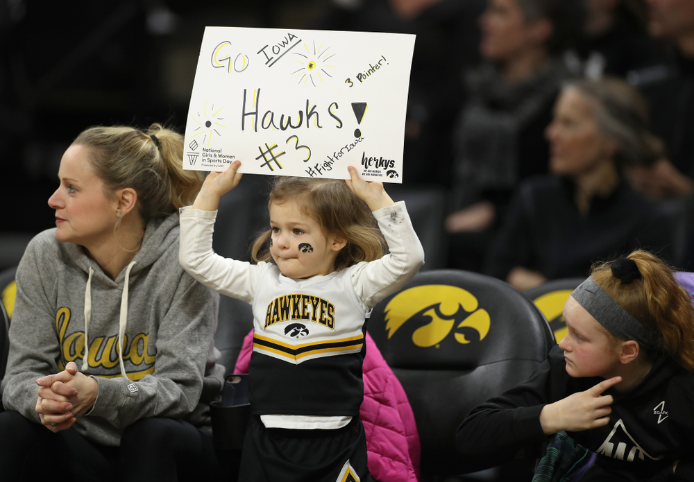 A young fan cheers on the Iowa Hawkeyes against Penn State Saturday, February 22, 2020 at Carver-Hawkeye Arena. (Brian Ray/hawkeyesports.com)
