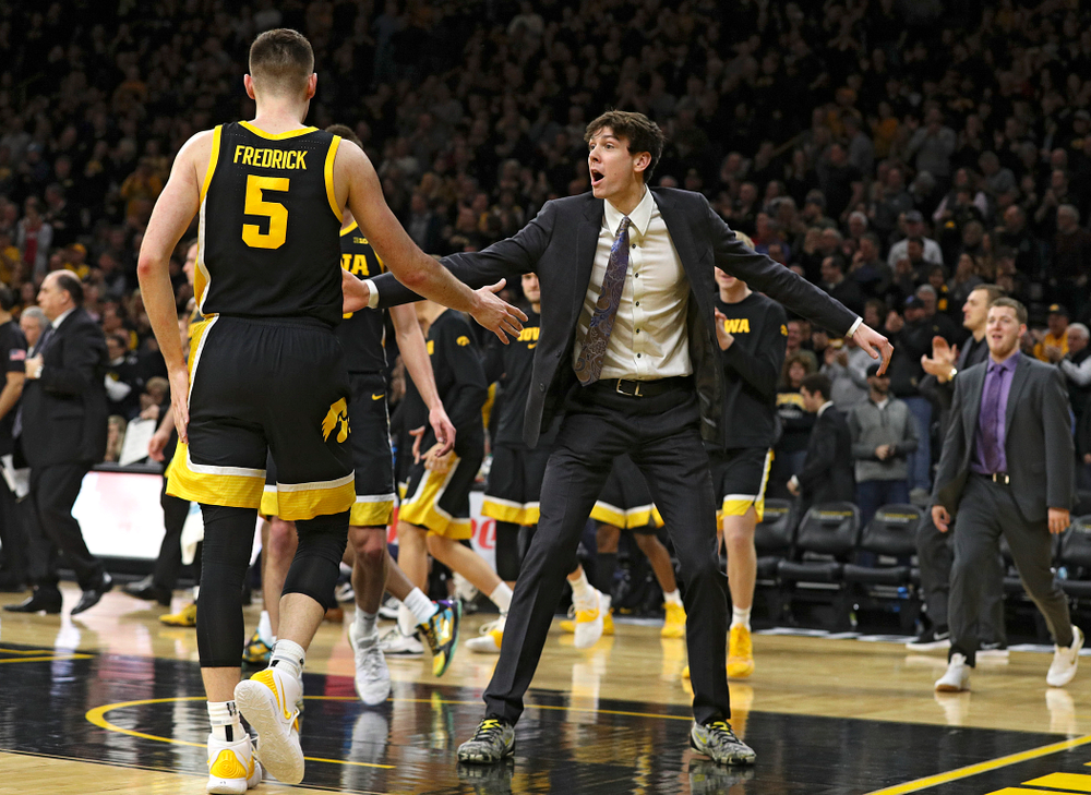Iowa Hawkeyes forward Patrick McCaffery (right) celebrates with guard CJ Fredrick (5) as he walks back to the bench for a timeout during the second half of their game at Carver-Hawkeye Arena in Iowa City on Monday, January 27, 2020. (Stephen Mally/hawkeyesports.com)